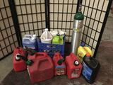 Collection of 5 empty gas cans, chainsaw oil, outboard lubricant, and more!