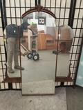 Vintage vanity mirror with carved accents. approx 52x43 inches.