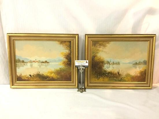 2 framed original oil paintings depicting seaside towns, both signed by E. Crail (?) 20x16x2 inches