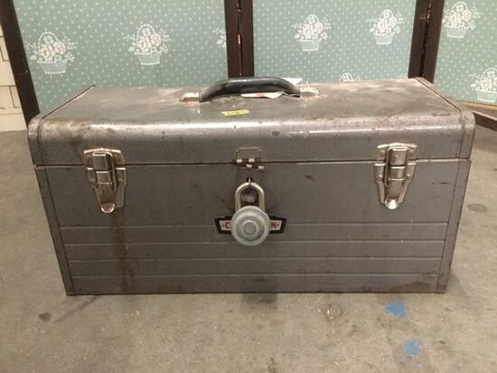 Vintage metal Craftsman tool box filled with hardware.