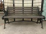 Antique wood & metal park bench w/elegant floral metalworking, approx. 51x24x30 inches.