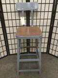 Metal shop stool w/ back rest, approx. 41x16x13 inches.