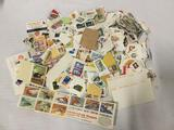 Large lot of hundreds of loose vintage postage stamps.