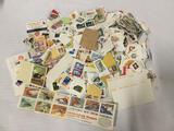 Large lot of hundreds of loose vintage postage stamps.