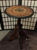 Vintage German smoking table with ceramic casters. Approx 18x18x28 inches.