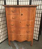 Vintage birds eye maple dresser with 5 shelves and a cabinet. Approx.35x20x50 inches.