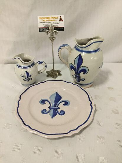 Set of three stoneware fleur-de-lis motif pieces signed by artist.