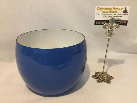Blue enameled bowl w/ white interior, makers mark has worn off, approx 8 x 6 inches