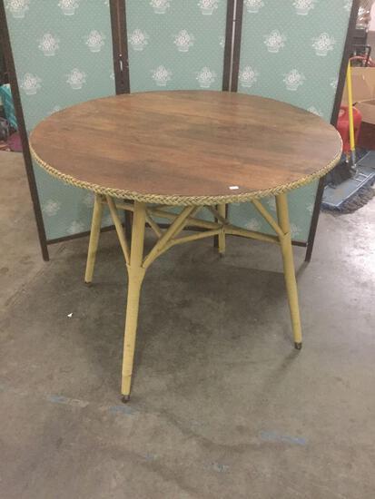 Vintage oak and wicker table.