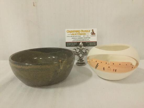 Two stoneware pottery bowls, one of which depicts an adobe building, both signed by artist Kat.