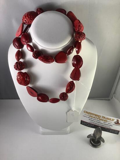 Red tone natural pit necklace, approx 32 inches long.