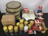 Large collection of car parts. Air filters, era, distributor cap, and more.