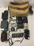 Collection of 12 digital and film cameras, untested. Nikon, canon, Kodak and more.