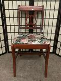 Mahogany dining chair w/floral cushion, approx. 16x21x33 inches.
