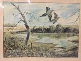 Print of birds on a pond.