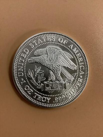 United States of America 1ozt 0.999 fine silver round trade unit.