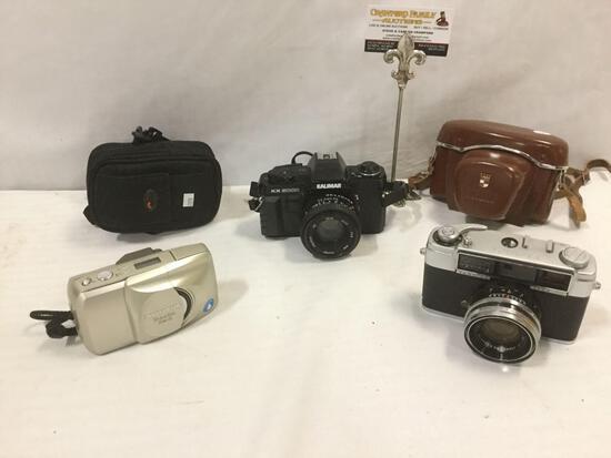 3 cameras: Olympus Stylus Epic Multi-AF Zoom 170mm, Kalimar KX 5000 w/50mm lens, Yashica LYNX-1000 +