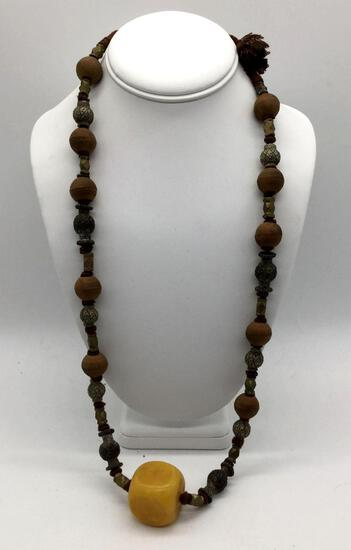 Vintage Asian metal, wood and resin bead necklace. Approx 18 inches.