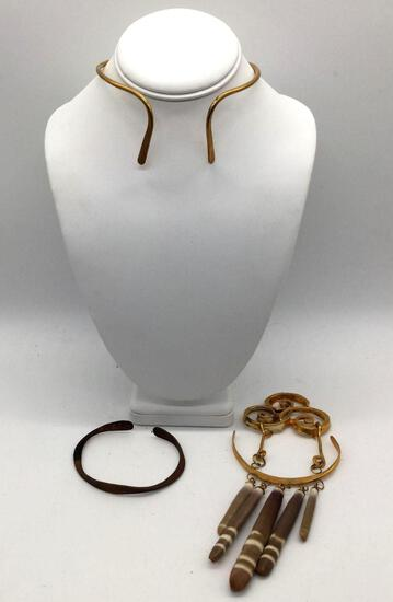 Lot of 3 traditional Asian jewelry pieces. Brass neck cuff, copper cuff bracelet, and stone pendant