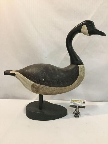 Hand carved and painted Canada Goose wood sculpture art piece. Approx 21x21x8 inches.