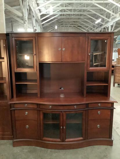 Lexington entertainment center w/ 6 drawers and 4 cabinets and curved glass doors. 72x67x21 in.