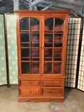 Modern solid wood curio/china cabinet w/4 drawers. Approx 70x39x18 inches.