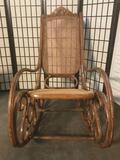 Vintage wicker rocking chair w/ elegant carved backrest, & swirling wood base, approx. 44x40x24 in.