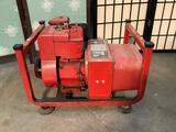 Vintage Briggs and Stratton 4 cycle 4 hp gasoline engine and AG Tronic alternator.