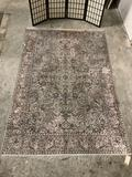 Vintage large handmade silk area rug with floral patterns. Approx 108x72 inches.