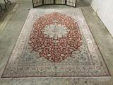 Large handmade silk rug w/floral pattern & fringe. Some minor wear to fringe. Approx. 112x73 inches.