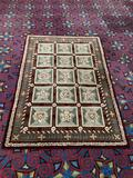 Wool area rug w/ dynamic floral patterning. Approx 96x63 inches.