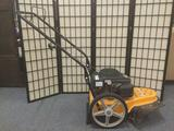 Cub Cadet ST 100 22 inch Wheeled String Trimer, tested & working. Only 10 hours of use on machine.