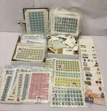 Hundreds of vintage mostly U.N. stamps, incl. dozens of sheets of U.N. stamps in sleeves, Dinosaurs+
