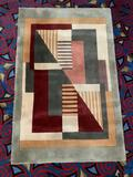 Modern Momeni New Wave collection geometric pattern wool rug. Approx 66x42 inches.