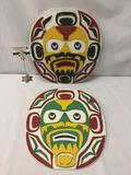 2 Kwakiutl applied wood bear/face effigies from Vancouver Island. Approx. 15x16x1 inches each.