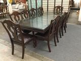 Large modern claw foot dining table w/ 10 upholstered dining chairs & 2 leaves.