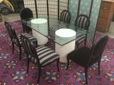 Modern table w/ composite pillar bases, glass top, & 6 chairs w/carved duck motif approx 72x36x30 in