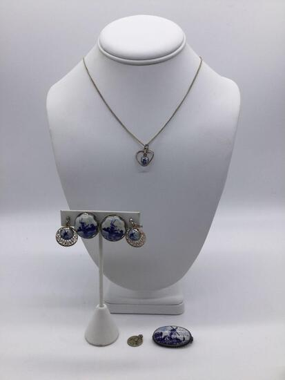 Collection of four pieces of Delft Blue and sterling silver jewelry pieces.