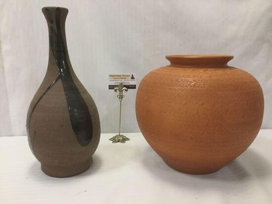 2 stoneware vases; large round orange vase & thin black sparsely glazed vase, approx 13x13x12 inches