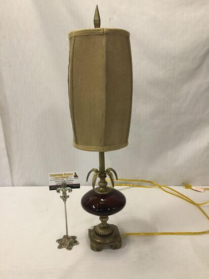 Metal and red glass decorative table lamp. Tested and working. Approx 26x7x7 inches.