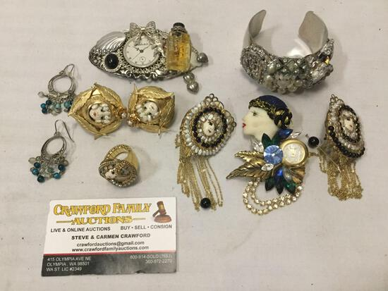 7 pieces of hand made fashion art jewelry, some with pearls, and come with clocks. Some signed!
