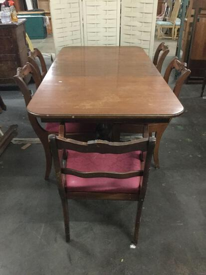 Vintage wood claw foot dining table w/ 5 upholstered chairs. Table approx 72x36x30 inches.