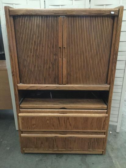 Modern rolling entertainment center with 2 drawers. Approx 54x34x17 inches