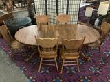 Antique style oak pedestal base claw foot dining table with 2 cleaves & 6 matching carved chairs