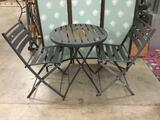 Metal patio table with two chairs.