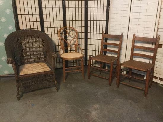 4 vintage chairs w/ wicker seats, incl. a wicker armchair & 3 wooden chairs. approx. 35x30x30 inches