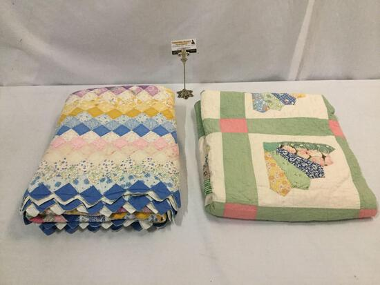 2 colorful quilts w/ geometric & floral patterns, some minor wear