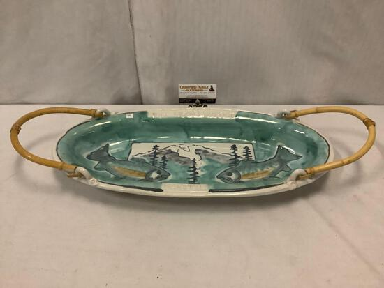 Hand painted and signed 2002 Pike Place handled bowl with salmon pattern. Approx 23x11x5 inches.