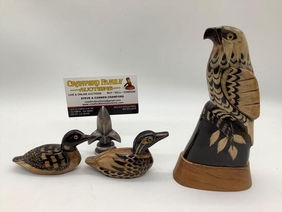 Lot of 3 hand carved buffalo horn scrimshaw bird figures. Duck, loon, and falcon. approx 6x3x2 inch