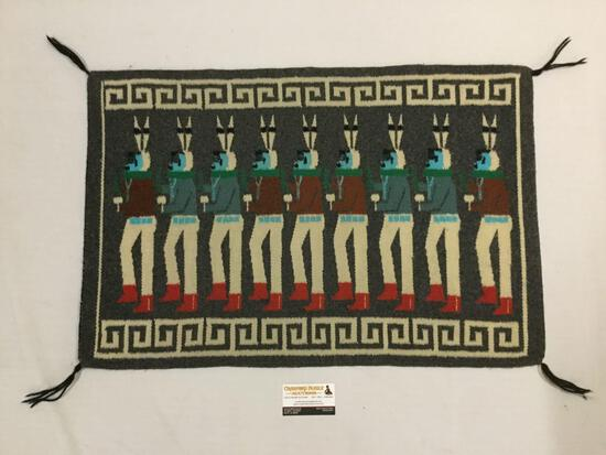 Small handwoven Native American rug with ceremonial scene.. Approx. 32x21 inches.